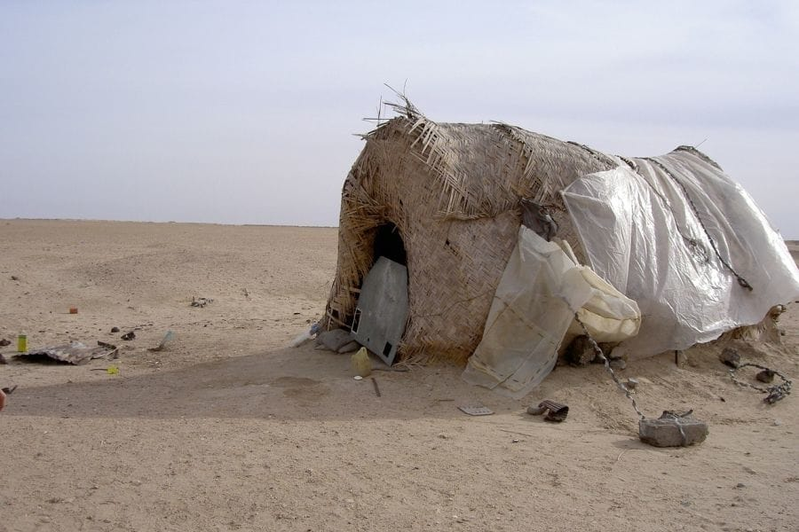 An emergency shelter made partially from plastic bags.
