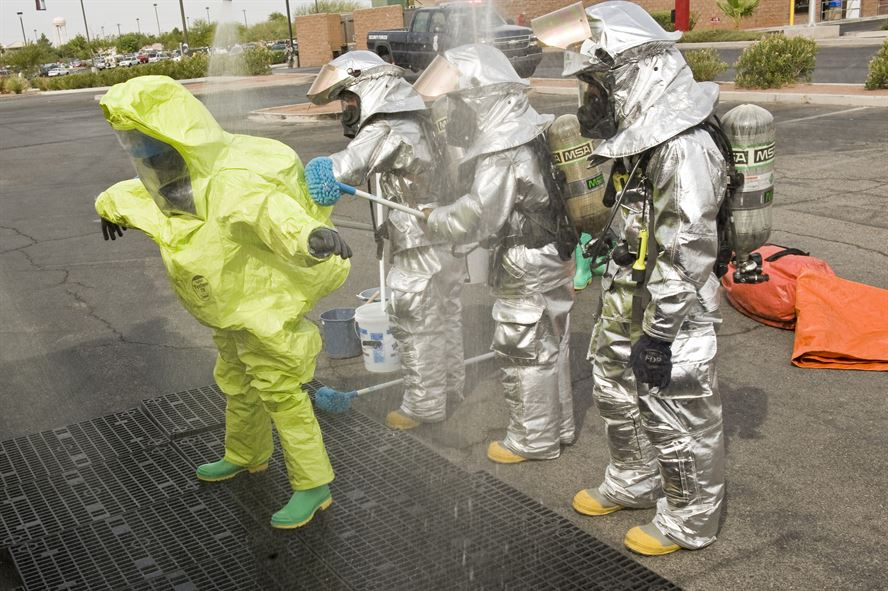 Emergency personnel performing decontamination.