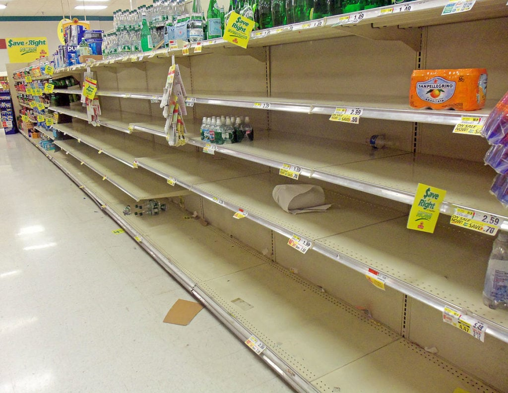 News of a hurricane prompt a run on food at the local grocery store.