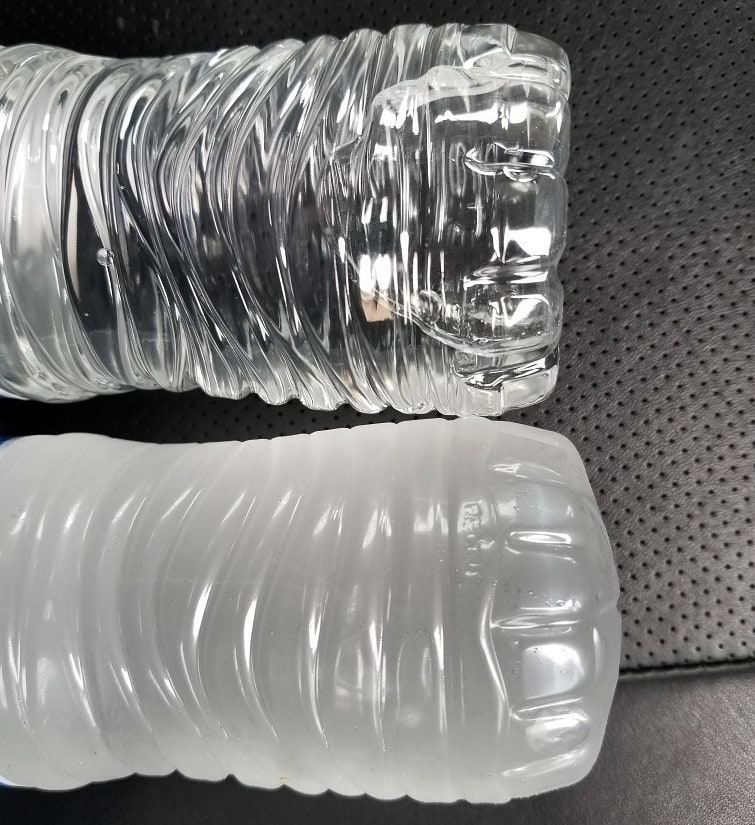 Frozen versus unfrozen bottles of water.