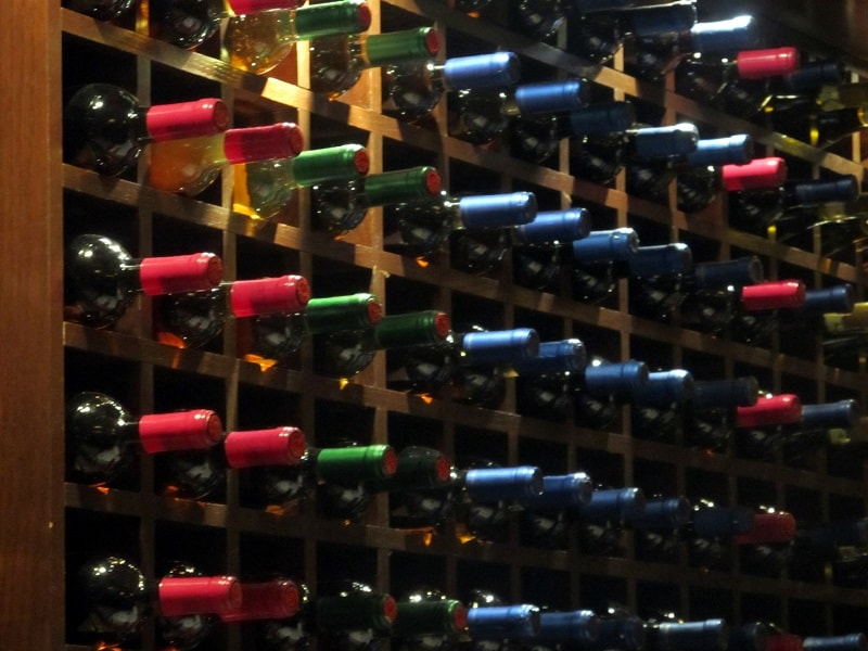 A wine rack with a large selection of wines.
